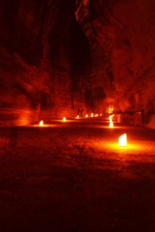 the ghostly figures of people walking along the path to Petra